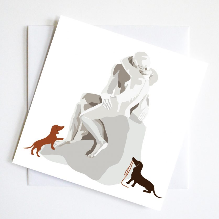 The Sculpture of Rodin's Kiss plus two dachshunds waiting at their feet make it a quick kiss