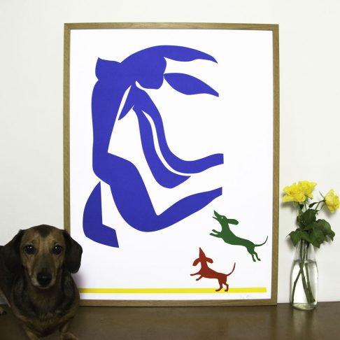 Our Dachshund print shows Matisse Blue Nude being chased by two cut out dachshunds.
