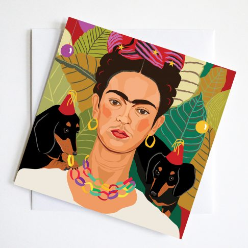 Frida Kahlo with small dachshunds in party hats turn this iconic image into a humorous parody Christmas Greeting