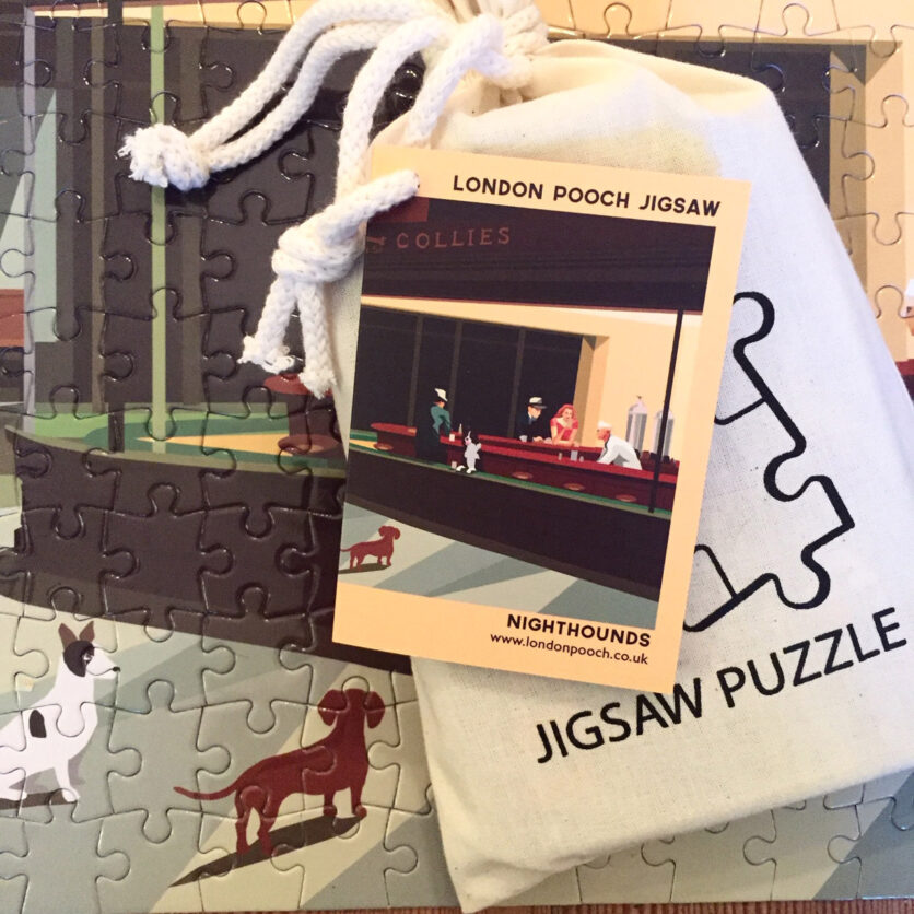 Jigsaw puzzle in a bag on part of the completedpuzzlethe